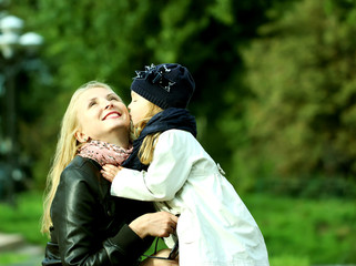 Доченька целует маму