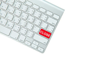 Red close button on computer keyboard isolated on white backgrou