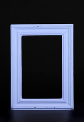 Wooden frame isolated on black.