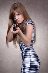 angry cute girl with gun