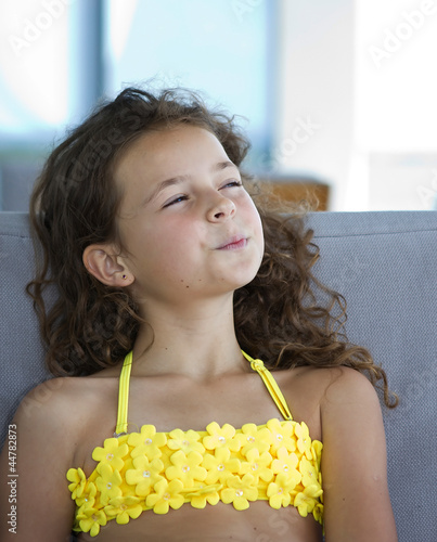 Portrait of a beautiful young girl in a yellow bikini for Beautiful small teen