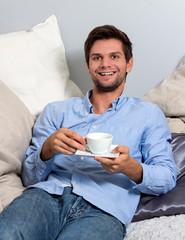 Young man enjoying a coffeebreak