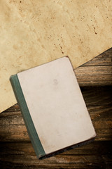 Weathered book and paper on wood