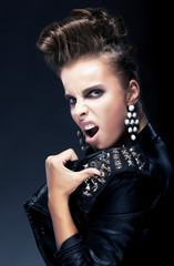 Subculture - punk female teenager, creative hairstyle screaming