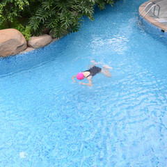 woman diving in a pool