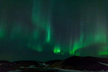 Northern lights over  craters in Iceland