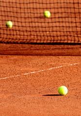 Wall Mural - Tennis balls on a tennis clay court