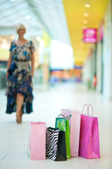 shopping bags in front of woman