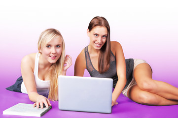 Friendship fun, two pretty girls on laptop