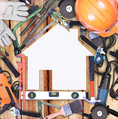 Selection of tools in the shape of a house, home improvement con