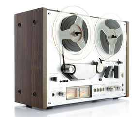 vintage analog recorder reel to reel on white background
