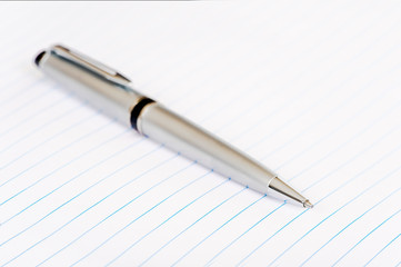 Elegant silver pen on lined note paper