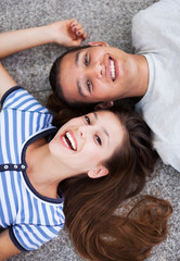 Happy young couple lying down
