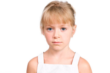 Sad little girl looking at camera with serious face isolated ove
