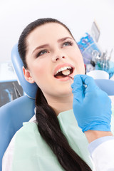 Dentist is looking for the defects in the oral cavity