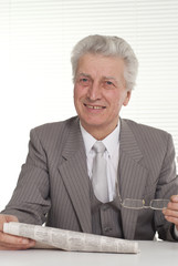 An businessman in glasses sitting