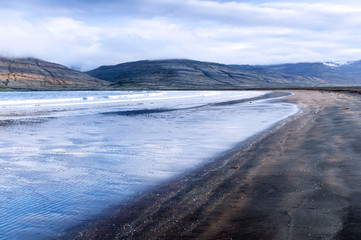 Black sand beach and blue sea, Iceland