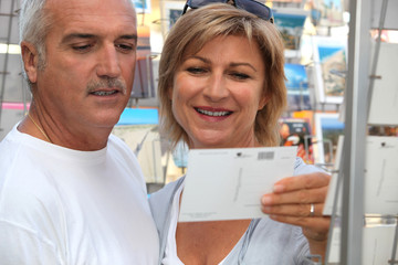 Couple buying post card