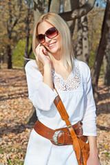 Happy beautiful caucasian woman has a phone call