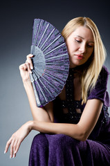 Beautiful woman with japanese fan