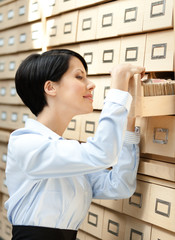 Woman looks for something in card catalog