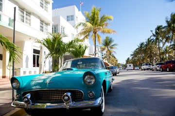 Photo on textile frame Old cars View of Ocean drive with a vintage car