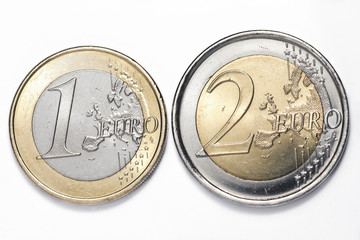 A one and a two euros coins isolated on a white background