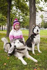 cute girl with husky dogs