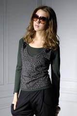High fashion model in fashion dress wearing sunglasse
