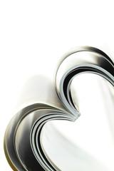 Selective focus image of magazine folded into a heart shape