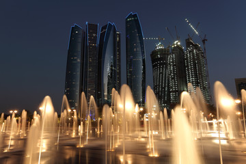Wall Mural - Skyscrapers in Abu Dhabi at dusk, United Arab Emirates