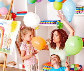 Child playing with balloon.