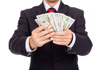 Business man holding money on white background