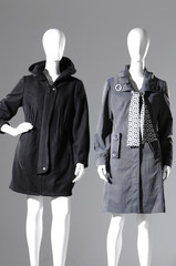 Two female coat on a gray background