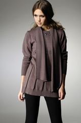 fashion model in autumn/winter clothes posing in the studio