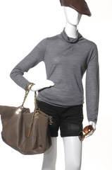 Fashion clothes on a mannequin holding bag in hat