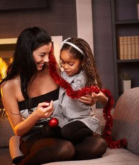 Happy mother and daughter at christmas