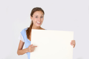 Cheerful young woman holding whiteboard , isolated
