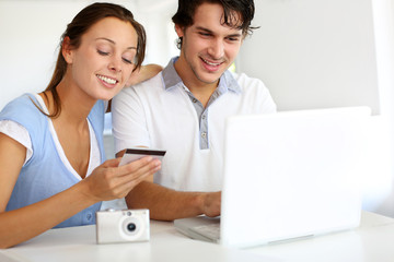 Couple having their pictures developed on internet
