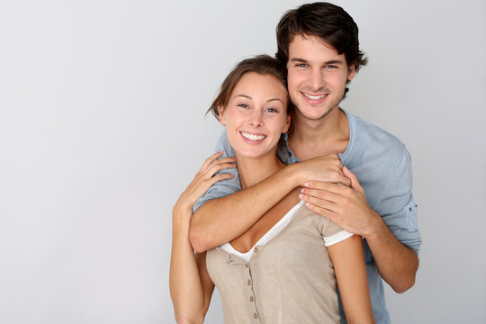 Cheerful young couple standing on white background, isolated
