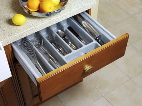Kitchen sliding case with fork, knife, and spoons