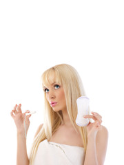 Woman holding cotton hygienic tampon and looking up at copyspace