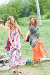 Two Beautiful Hippie Woman Dancing in the Countryside