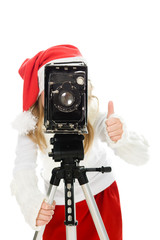 Girl in a Christmas costume with old camera