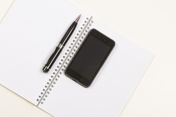 Notebook, pen and mobile phone - handphone