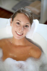 Upper view of gorgeous woman taking a bath