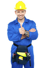 Young industrial contractor showing thumbs up