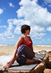 Woman in half spinal twist yoga pose