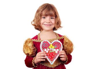 Wall Mural - little girl holding gingerbread heart