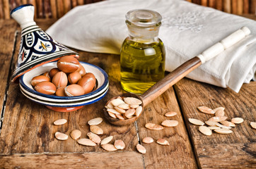 Still life of argan fruit and oil